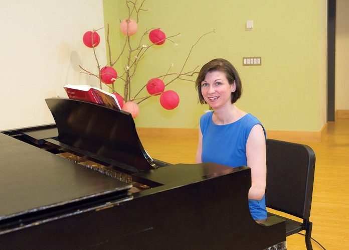 "RECONNECTING: Christine Noel co-founded the Rhode Island Children's Chorus because she missed the ""opportunity to connect with young people"" while working abroad at the University of Florence in Italy, where she lived for nearly two years. / PBN FILE PHOTO/TRACY JENKINS"