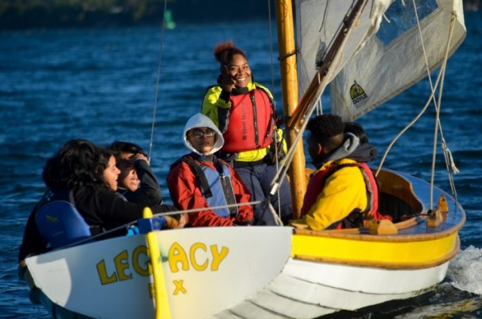 STUDENTS FROM ROCKING THE BOAT are pictured sailing on the Hudson River. / COURTESY ROCKING THE BOAT/11TH HOUR RACING