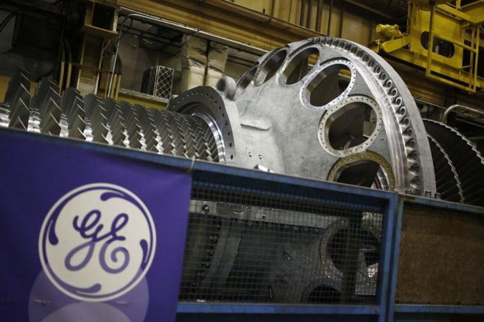 GENERAL ELECTRIC CO. has agreed to merge its locomotive business with Wabtec Corp. in a deal valued at $11.1 billion. /BLOOMBERG FILE PHOTO/LUKE SHARRETT