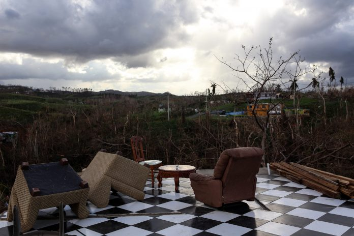 IN A NEW STUDY, Harvard estimated that roughly 5,000 people in Puerto Rico died due to Hurricane Maria. The official death toll remains 64 people. Above, furniture sits in a home destroyed after Hurricane Maria in Corozal, Puerto Rico. / BLOOMBERG FILE PHOTO/ALEX WROBLEWSKI