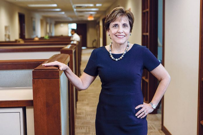 BUILDING WEALTH: Edythe M. De Marco, founder of The De Marco Group at Merrill Lynch Wealth Management in Providence, wants to encourage more women to work in the financial-services industries, and takes pride in training talented people to grow their clients' assets. / PBN PHOTO/RUPERT WHITELEY