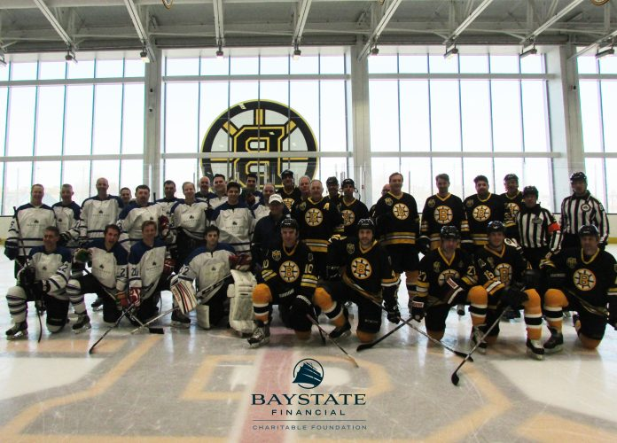 BAYSTATE FINANCIAL raised $35,000 to donate to organizations that help children through its fifth annual charity hockey game against the Boston Bruins Alumni team, pictured above with members of the Baystate Financial All-Stars team. / COURTESY BOSTON BRUINS
