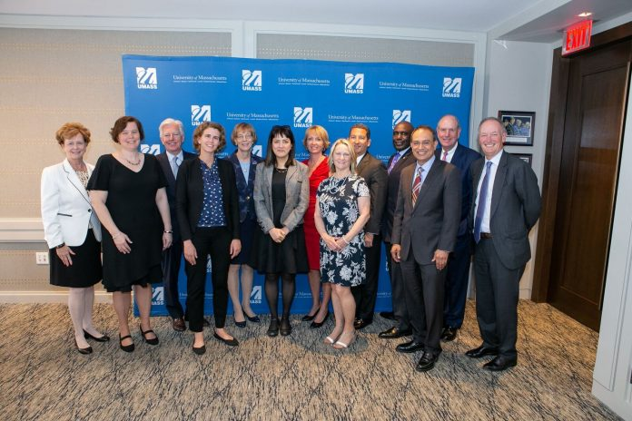 UMASS DARTMOUTH professor Pamela Karimi was awarded the 2018 Manning Prize for teaching along with faculty from the four other UMass campuses. Above, from left to right, UMass Lowell Chancellor Jacquie Moloney, UMass Amherst professor Linda Isbell, UMass President Marty Meehan, UMass Boston professor Olivia Weisser, UMass Lowell lecturer Deborah Finch, UMass Dartmouth professor Pamela Karimi, UMass Lowell alum and prize co-founder Donna Manning, UMass Medical School professor Anne Gilroy, UMass Lowell alum, prize co-founder and Board of Trustees Chairman Rob Manning, UMass Dartmouth Chancellor Robert E. Johnson, UMass Amherst Chancellor Kumble Subbaswamy, UMass Medical School Chancellor Michael Collins and UMass Boston Chancellor Barry Mills. / COURTESY UMASS DARTMOUTH/ROB CARLIN