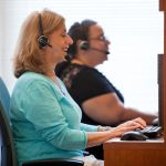 UNITED WAY of Rhode Island 211 operators, from left, Tina Donate and Aura Sanabia field calls at their Providence call center. / COURTESY UWRI