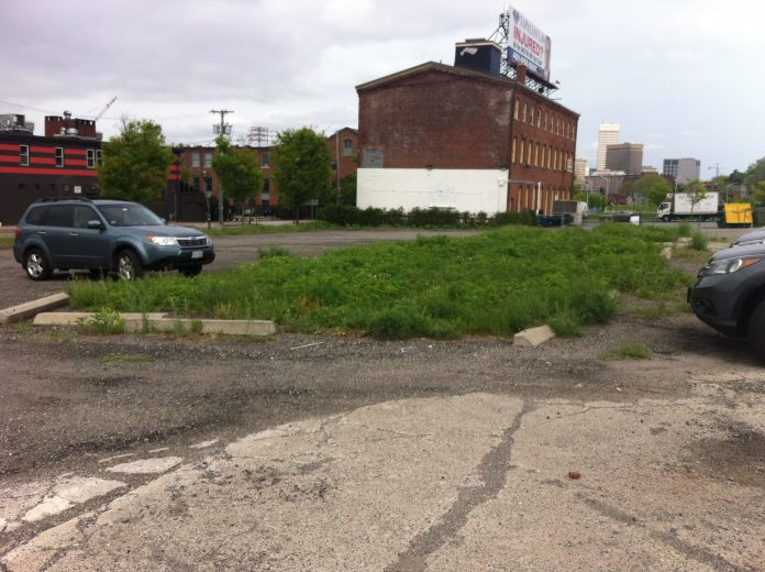 A FIVE-STORY BUILDING of 44 condominium units and retail space is being proposed for a surface parking lot near Interstate 195 and South Water Street in the Fox Point neighborhood of Providence. / PBN PHOTO/MARY MACDONALD