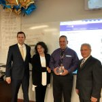 TREASURER SETH MAGAZINER presents North Providence High School teacher Anthony Avicolli with the 2018 Financial Literacy Educator of the Year award. From left, Magaziner; Deb Avicolli, Anthony's wife; Avicolli; and North Providence Mayor Charles A. Lombardi. / COURTESY R.I. OFFICE OF GENERAL TREASURER