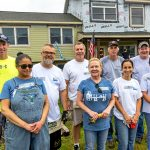 HOUSING HANDS: Town Dock employees volunteer with Habitat for Humanity to renovate a house in the Bradford village of Westerly last August.