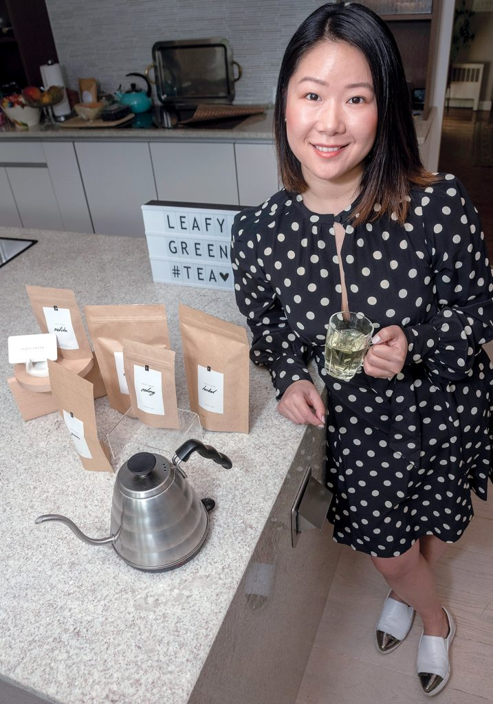 "ARTISAN TEA: Michelle Cheng, owner and founder of Leafy Green, a tea company based out of Hope & Main in Warren, prioritizes single-origin tea leaves purchased directly from farmers to elevate her tea to ""artisan status."" / PBN PHOTO/MICHAEL SALERNO"