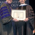 HONORARY DEGREE: Neil D. Steinberg, right, president and CEO of the Rhode Island Foundation, receives the honorary doctorate of humane letters degree from New England Institute of Technology President Richard I. Gouse. / COURTESY NEW ENGLAND INSTITUTE OF TECHNOLOGY