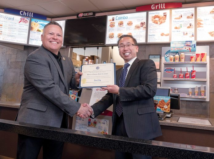 GRAND OPENING: DQ Grill and Chill co-owner Will Dailey, left, receives an official certificate from Cranston Mayor Allan Fung celebrating the grand opening of the restaurant. / PBN PHOTO/MICHAEL SALERNO