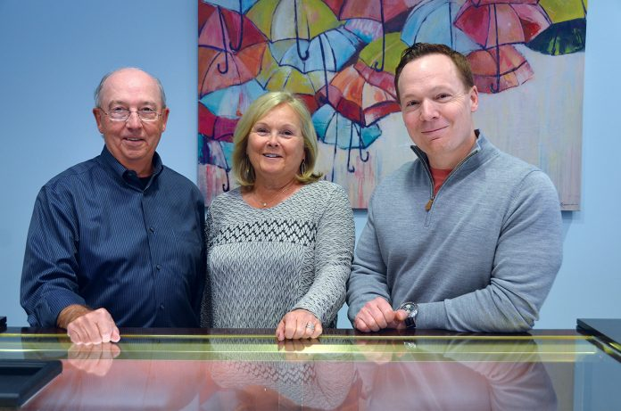 FAMILY-RUN: Joe Audette, left, owner and president of M.R.T. Jewelers, runs his business with his wife, Janice, and son David, vice president. The family-run business offers jewelry repair and sales. / COURTESY M.R.T. JEWELERS