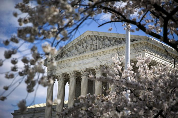 THE U.S. SUPREME COURT decision on labor unions' rights to collect fees from nonmembers could negatively impact their ability to negotiate and bargain with municipal and state governments where the practice was previously allowed. / BLOOMBERG FILE PHOTO/AL DRAGO