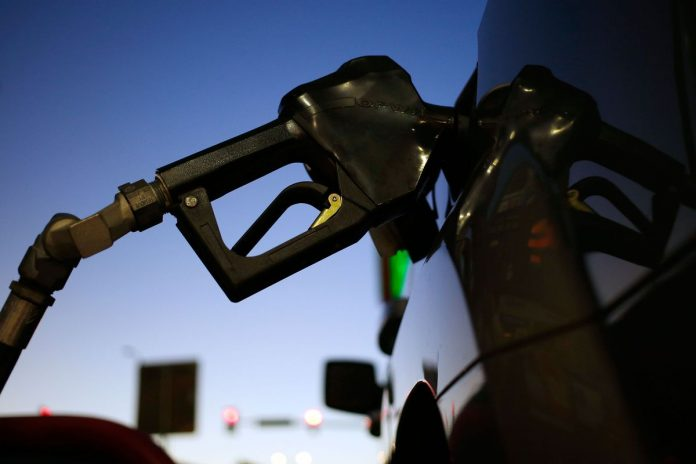 GAS PRICES IN RHODE ISLAND and Massachusetts both declined this week by a few cents, but remain significantly higher than they were one year ago. / BLOOMBERG FILE PHOTO/LUKE SHARRETT