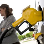 RHODE ISLAND regular gas prices increased 2 cents this week to average $2.95 per gallon, 11 cents above the national average. / BLOOMBERG FILE PHOTO/DANIEL ACKER
