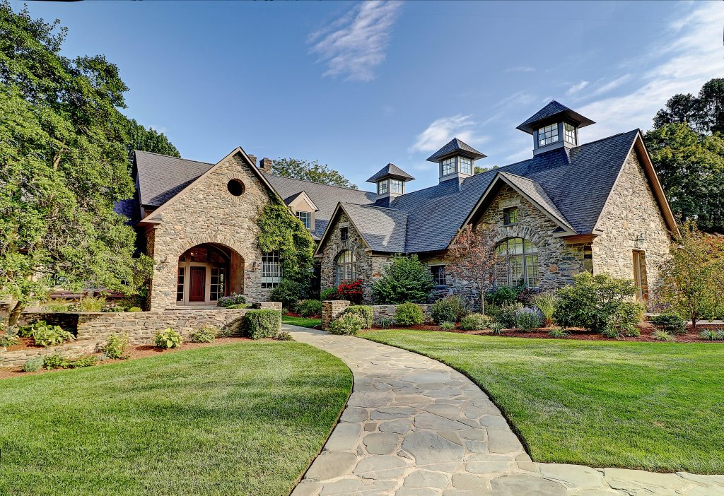 THE HOME at 266 Rumstick Rd. in Barrington features stone walls, five bedrooms and a temperature-controlled wine room. / COURTESY RPL