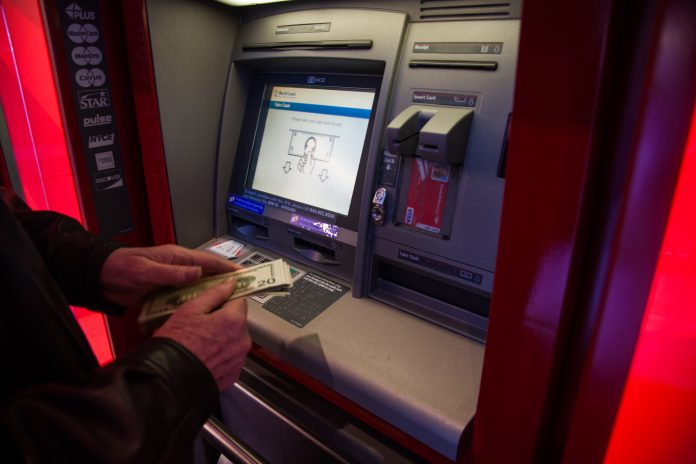 SOME TOURISM LEADERS in the state believe that ATM-use data could help the industry better understand who is visiting Rhode Island. / BLOOMBERG FILE PHOTO/DANIEL TEPPER