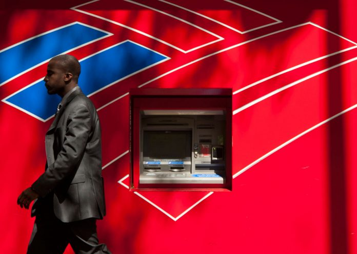 BANK OF AMERICA considering whether to reverse a decision it made two years ago to remove broker commissions from Merrill Lynch retirement accounts. The move comes after the fiduciary rule was struck down in March by a U.S. appeals court. / BLOOMBERG FILE PHOTO/DAVIS TURNER