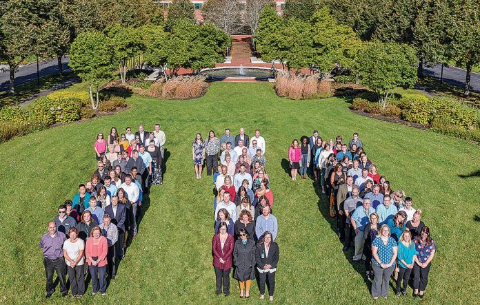 CELEBRATION OF THE CENTURY: Amica employees celebrate the company's 111th anniversary in Amica's Lincoln campus courtyard.