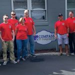 FENWAY MEET: Compass IT Compliance employees meet for a September 2017 trip to Fenway Park in Boston.
