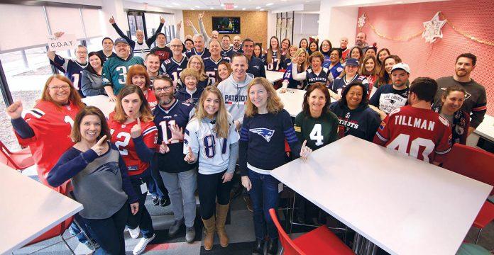 BUILT FOR SUCCESS: Gilbane employees show off their NFL team pride during the company's show-your-colors day. / COURTESY GILBANE INC.