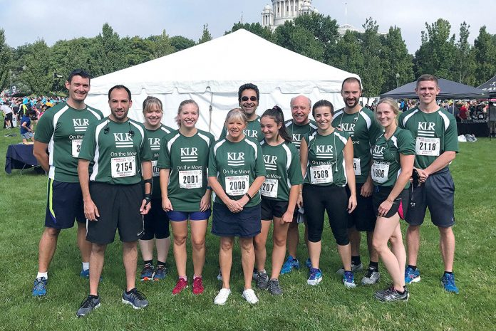 CHARITY RUN: Khan, Litwin, Renza employees team up for the CVS Downtown 5K charity run in Providence in September 2017. / COURTESY Kahn, Litwin, Renza & Co. Ltd.