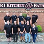 SOCIAL AND CHARITABLE: Rhode Island Kitchen & Bath employees outside their Warwick office in May. 