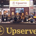 SERVE'S UP: The Upserve team touts the benefits the company offers at the National Restaurant Association Conference in Chicago. / COURTESY UPSERVE