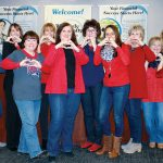 HEARTY ATTIRE: Westerly Community Credit Union members dress in red for Go Red for Women dress down day in February. / COURTESY WESTERLY COMMUNITY CREDIT UNION