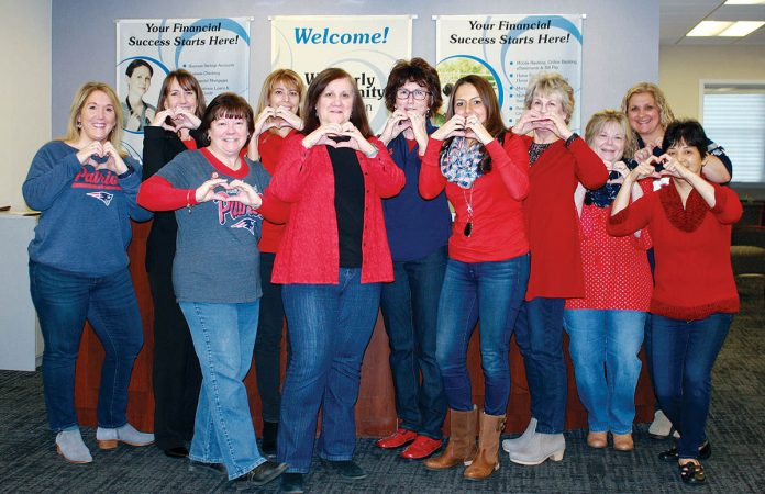 HEARTY ATTIRE: Westerly Community Credit Union members dress in red for Go Red for Women dress down day in February.