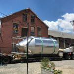 ONE OF THREE new 300-barrel fermentation tanks arrive at the Pawtucket-based Isle Brewers Guild Thursday. The brewing cooperative confirmed to PBN Thursday it is undergoing a three-pronged expansion. / COURTESY JEREMY DUFFY