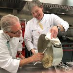 ROLLIE WESEN, right, co-founder and chief operations officer of the Jacques Pépin Foundation and a culinary professor at Johnson & Wales cooks with with Chef Ron Lewis, left, instructor with the Food Bank's Community Kitchen program. / COURTESY RHODE ISLAND FOOD BANK