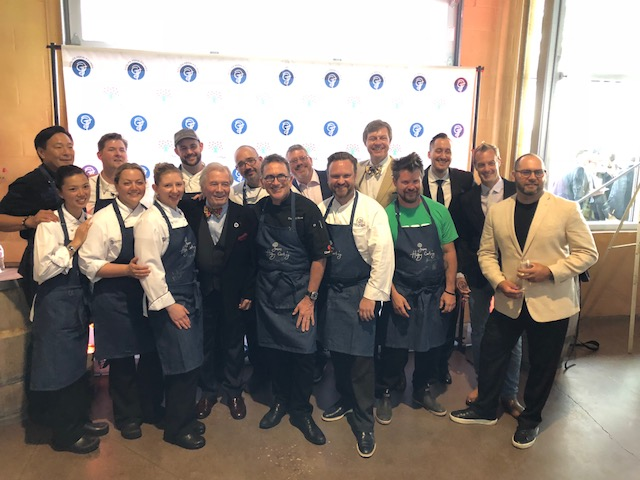 CELEBRITY CHEFS surround special guests Jacques Pepin, Sarah Moulton and Rick Moonen at last night's fund-raiser for the Rhode Island Community Food Bank. Over $180,000 was raised to support the Food Bank's Community Kitchens culinary job training program. / COURTESY RHODE ISLAND FOOD BANK