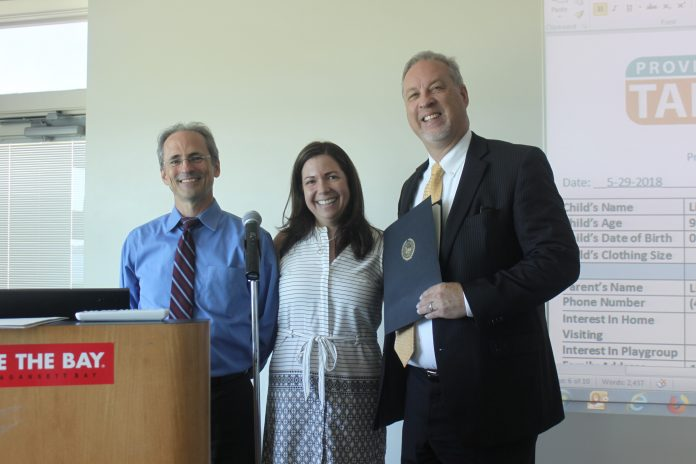 THE PROVIDENCE COMMUNITY HEALTH CENTERS recently received a Citizen Citation from Providence Mayor Jorge O. Elorza for the organization's ongoing efforts to improve childhood literacy through collaboration with the Providence Talks program. From left, Dr. Andrew Saal, chief medical officer at PCHC; Melissa Menders, executive director for Providence Talks; and Merrill Thomas, CEO at PCHC. / COURTESY PROVIDENCE MAYOR'S OFFICE