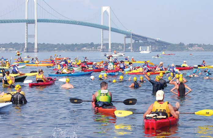 Swimmers and kayakers in the fourth wave of the 40th Save The Bay Swim in August 2016 get ready to start their 1.7-nautical-mile challenge from Newport to Jamestown. The 42nd annual event will take place Saturday, Aug. 4. / COURTESY SAVE THE BAY