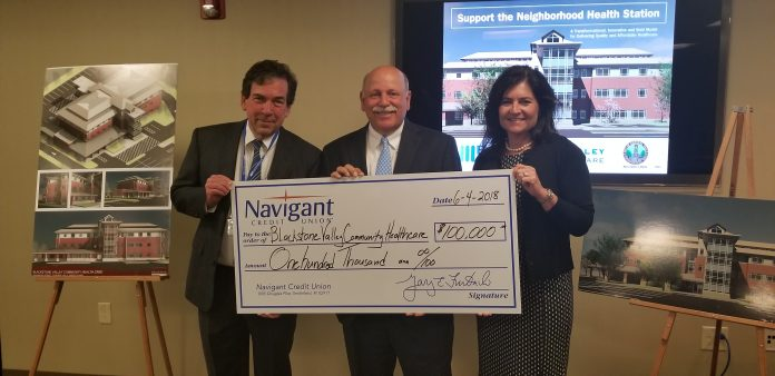 NAVIGANT CREDIT UNION recently provided a $100,000 grant toward the Central Falls Neighborhood Health Station, a project by Blackstone Valley Community Health Care. From left: Raymond Lavoie, BVCHC executive director; Gary Furtado, president and CEO of Navigant Credit Union; and Lisa Dandeneau, executive vice president and chief operating officer for Navigant Credit Union. / COURTESY BLACKSTONE VALLEY COMMUNITY HEALTH CARE