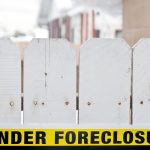 MORTGAGE DELINQUENCY of 30 days or more in the Providence metro area declined 0.7 percentage points year over year in March. The area also experienced a decline in serious delinquency and foreclosure rates. / BLOOMBERG FILE PHOTO/DAVID CALVERT