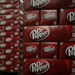 A NATIONAL SALES executive for Dr. Pepper/Seven Up Inc., a subsidiary of Dr. Pepper Snapple Group, was sentenced to 33 months in federal prison for $1.7 million in fraud against Dr. Pepper and federal tax evasion on those earnings. / BLOOMBERG FILE PHOTO/LUKE SHARRETT