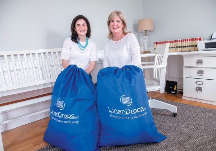 HEAVY LOAD: Rosa Ciunci, left, and Maureen Pagliaro, co-founders of LinenDrops.com, provide linen services for vacation and short-term rental properties throughout the region.