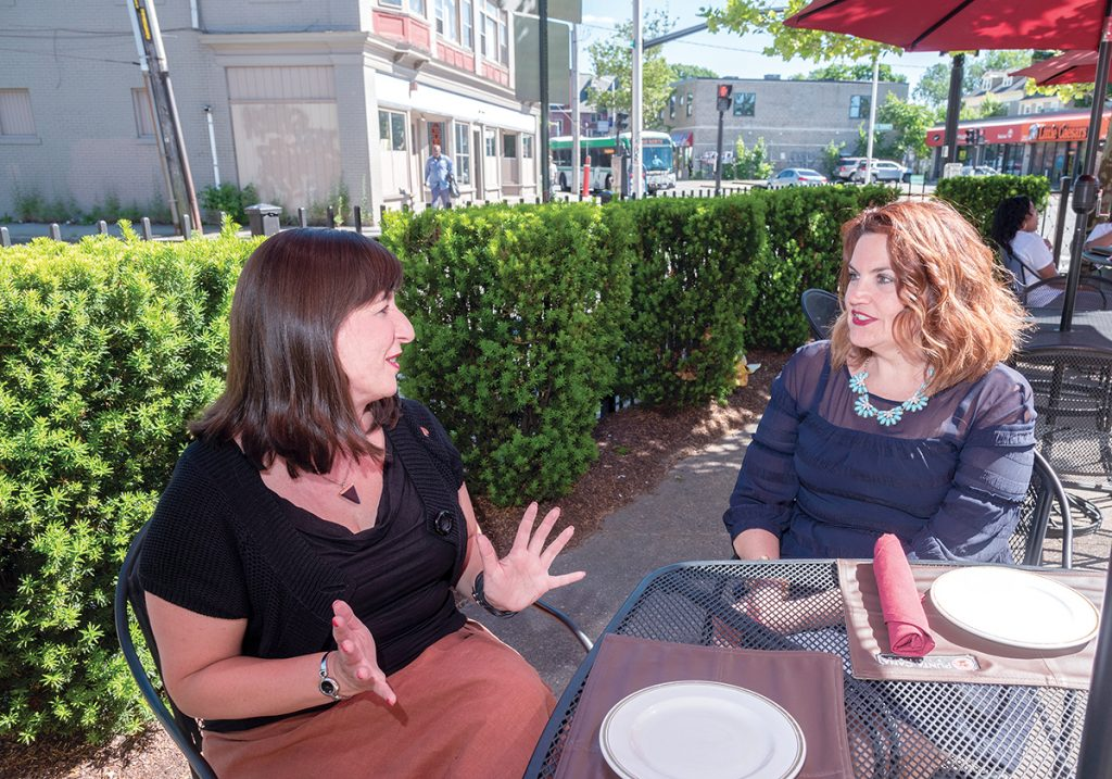 ENTICING OFFER: Stephanie P. Fortunato, left, Providence's director of arts, culture and tourism, and Kristen Adamo, Providence Warwick Convention & Visitors Bureau vice president of marketing and communications, say the goal of the PWCVB's recently launched online Providence neighborhood guide is to provide as much information as possible to entice potential tourists to visit. / PBN PHOTO/MICHAEL SALERNO
