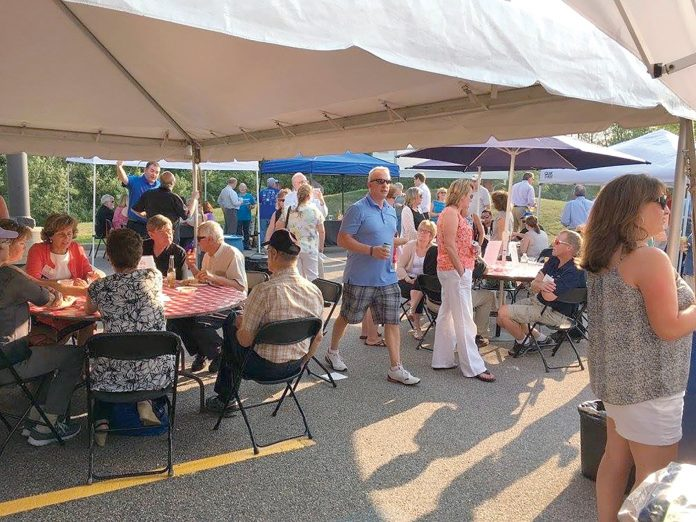 BUSINESS BARBECUE: Attendees gather for the Tri-Town Chamber of Commerce's summer business barbecue in Mansfield in 2016. This year's event welcomes all businesses regardless of Chamber membership and will be held July 26 at the Tri-Town Chamber of Commerce in Mansfield. / COURTESY TRI-TOWN CHAMBER OF COMMERCE