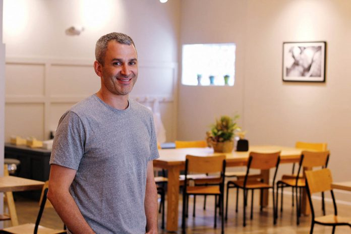 AGGRESSIVE GROWTH: Adam Lastrina, co-owner of Knead Doughnuts, is pictured at the company's newest location at 135 Elmgrove Ave. on the East Side in Providence, which opened in April. The company opened its first location in downtown Providence in December 2016 and hopes to open four locations within five years.