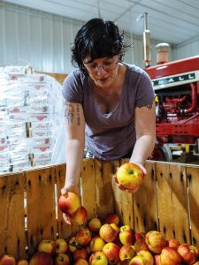 GLEANING: Eva Agudelo launched Hope's Harvest Rhode Island in February. The nonprofit performs a process known as gleaning, in which it works with farms and food-service organizations to identify excess food and transport it to organizations that serve it to those in need.