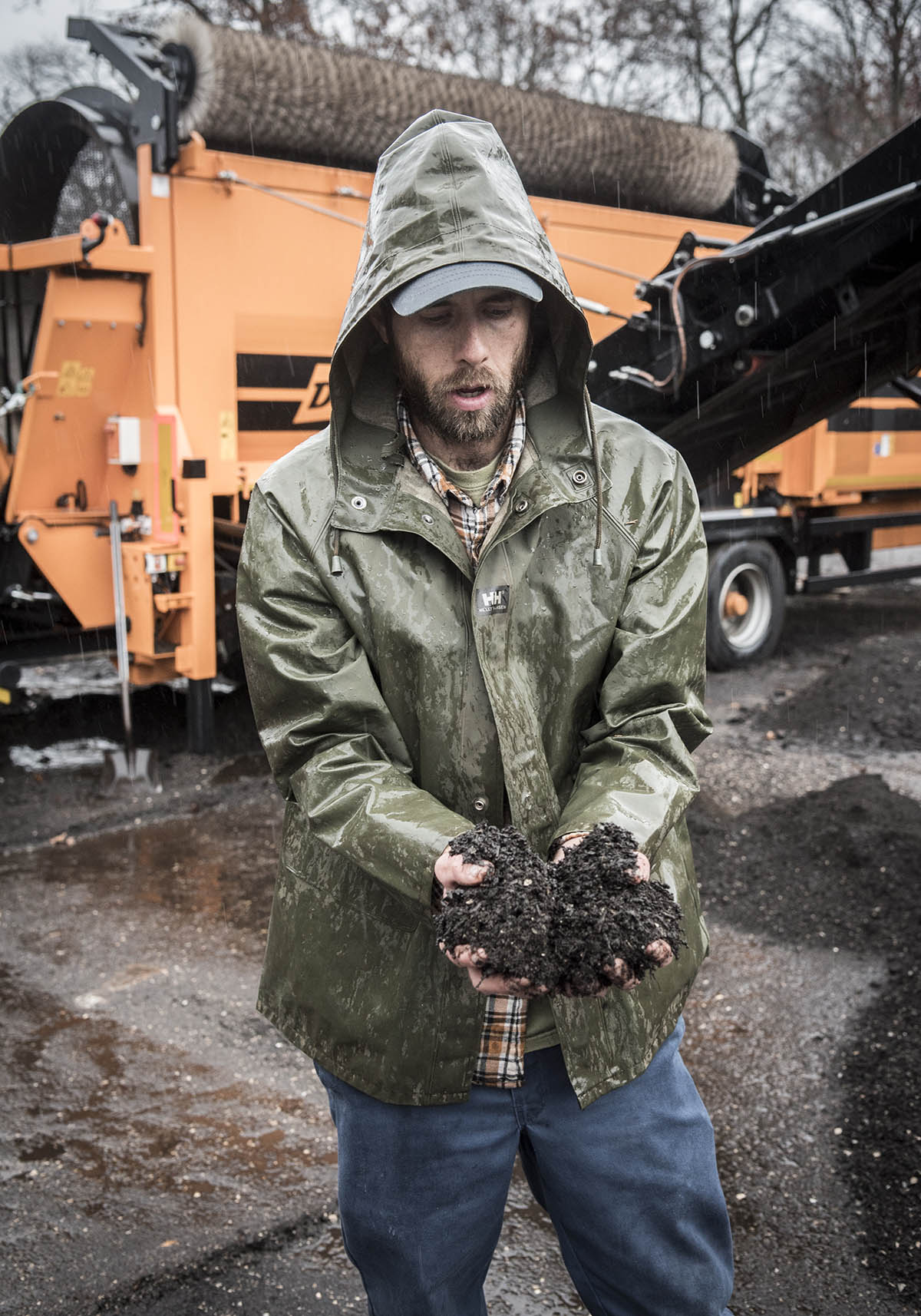 FINISHED PRODUCT: Sam Fox, a former assistant manager at Earth Care Farm in Charlestown, shows a handful of finished compost. The farm is the state's largest facility at which commercial-scale food-waste producers can divert materials to keep them out of the Central Landfill in Johnston. / PBN FILE PHOTO/MICHAEL SALERNO