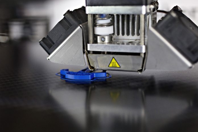 3-D PRINTERS SUCH AS this one making a watch component could potentially be used to make firearms. A number of state attorneys general have filed suit to keep a Texas nonprofit from releasing plans for making guns with a 3-D printer. / BLOOMBERGER NEWS PHOTO/MICHELE LIMINA