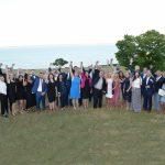 THE 2018 CLASS OF PBN's 40 Under Forty program celebrate on the lawn of the Aldrich Mansion with Nassagansett Bay in the background on Thursday. / PBN PHOTO/MIKE SKORSKI