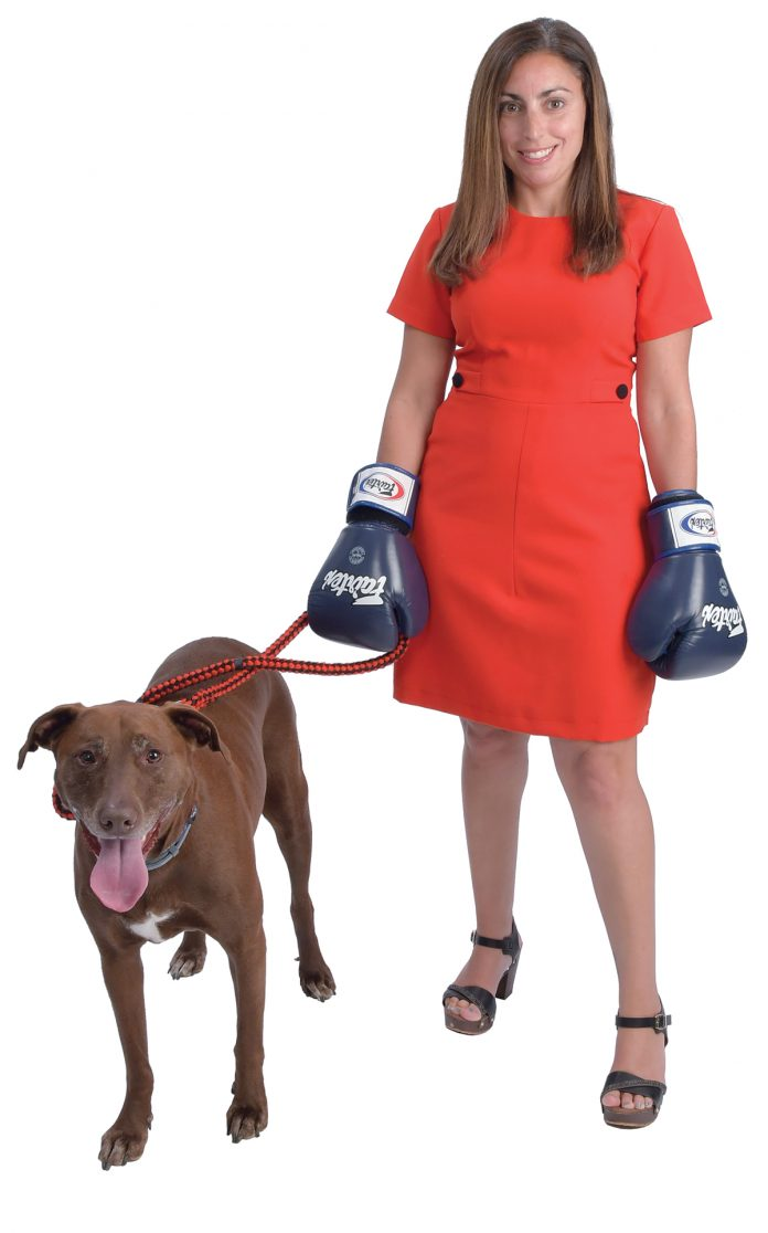 "the prop: Rebecca Plonsky's dog's name is Gronk – after Rob Gronkowski of the Patriots. ""We rescued him five years ago."" The boxing gloves for muay thai kickboxing help her to stay humble and healthy. / PBN PHOTO/MIKE SKORSKI"