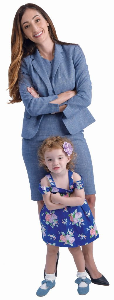 """the prop: Joelle Rocha and her daughter Avery, 2. """"She's awesome. I figured I'd bring her into the photo, so she can look back and see mommy did something she can be proud of."""" / PBN PHOTO/MIKE SKORSKI"""