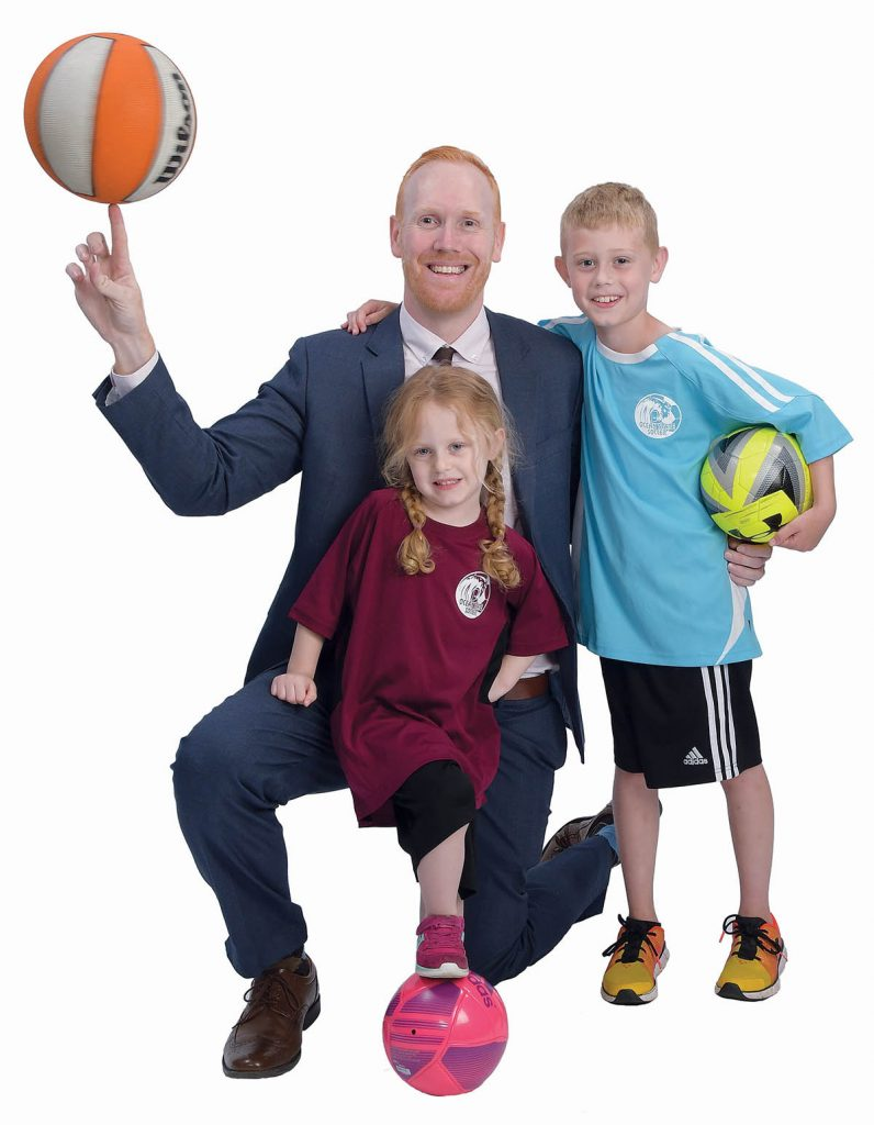 """the prop: Velander's son Keelan, 7, and daughter Penelope, 4, in their soccer uniforms, as well as a basketball, since he plays a lot and has since he was 5 years old. """"We spend a lot of time together.""""  / PBN PHOTO/MIKE SKORSKI"""