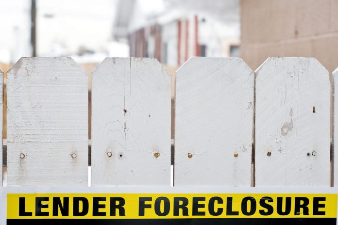 MORTGAGE DELINQUENCY IN the Providence metro area declined 1.1 percentage points year over year to 4.8 percent in April. The foreclosure rate in the area was 0.7 percent, a decline from 1 percent in April 2017. / BLOOMBERG NEWS FILE PHOTO/DAVID CALVERT