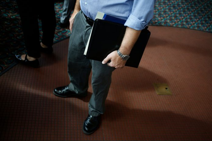 UNITED STATES filings for unemployment benefits declined to a two-month low: last week. / BLOOMBERG FILE PHOTO/LUKE SHARRETT